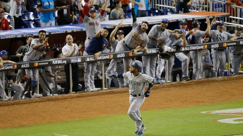 The American League team cheer Seattle Mariners Robinson Cano (22), after he hit a home run in the tenth inning, during the MLB baseball All-Star Game, Tuesday, July 11, 2017, in Miami. The American League defeated the National League 2-1. (AP Photo/Alan Diaz)