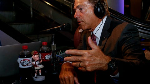 Alabama NCAA college football coach Nick Saban speaks with a radio show during the Southeastern Conference's annual media gathering, Wednesday, July 12, 2017, in Hoover, Ala. (AP Photo/Butch Dill)