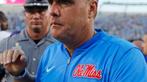 FILE - In this Sept. 17, 2016, file photo, Mississippi head coach Hugh Freeze walks off the field following a loss to No. 1 Alabama in an NCAA college football game, in Oxford, Miss. Gus Malzahn, Kevin Sumlin and Hugh Freeze arrived in the SEC West with reputations for breakneck fast offenses and winning, and have had seasons where they lived up to the billing. All three find themselves potentially on the hot seat, while it's getting a little warm for Arkansas' Bret Bielema and Tennessee's Butch Jones. (AP Photo/Rogelio V. Solis, File)