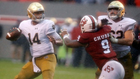 FILE - In this Oct. 8, 2016, file photo, North Carolina State defensive end Bradley Chubb (9) tries to get to Notre Dame quarterback DeShone Kizer (14) as Notre Dame offensive lineman Colin McGovern (62) blocks during the first half of an NCAA college football game at Carter-Finley Stadium, in Raleigh, N.C. Chubb believes there's an art to pass rushing, that it's more than just running to the quarterback. (Ethan Hyman/The News & Observer via AP, File)