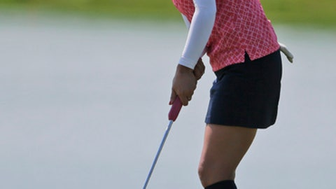 Ai Miyazato, of Japan, putts on the 18th green during a practice round for the U.S. Women's Open Golf Championship at Trump National Golf Club in Bedminster, N.J., Wednesday, July 12, 2017. (AP Photo/Seth Wenig)