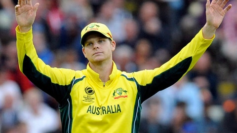 "FILE - In this June 10, 2017 file photo, Australia captain Steve Smith gestures during the ICC Champions Trophy match between England and Australia at Edgbaston in Birmingham, England. The chairman of Cricket Australia has heavily criticized the country's top players for their stance in a two-week-long pay dispute, and accused the Australian Cricketers' Association of a ""reckless strategy that can only damage the game, in an opinion piece in The Australian newspaper on Thursday, July 13, 2017. (AP Photo/Rui Vieira, File)"