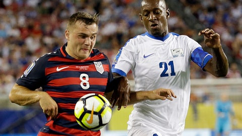 United States' Jordan Morris (8) moves the ball past Martinique's Sebastien Cretinoir (21) during a CONCACAF Gold Cup soccer match, Wednesday, July 12, 2017, in Tampa, Fla. (AP Photo/John Raoux)