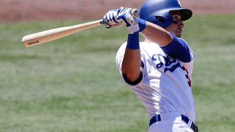 FILE - In this June 25, 2017, file photo, Los Angeles Dodgers' Cody Bellinger watches his two-run home run against the Colorado Rockies during the third inning of a baseball game, in Los Angeles. The Dodgers already have overcome the losses of injured veterans Adrian Gonzalez and Andre Ethier, along with Andrew Toles, thanks to the offensive prowess of Turner and NL rookie of the year candidate Cody Bellinger. (AP Photo/Chris Carlson, File)