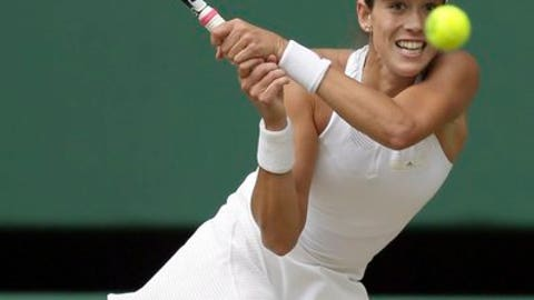 Spain's Garbine Muguruza returns to Slovakia's Magdalena Rybarikova during their Women's Singles semifinal match on day nine at the Wimbledon Tennis Championships in London Thursday, July 13, 2017. (AP Photo/Tim Ireland)
