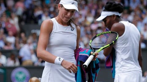 Venus Williams of the United States, right, and Britain's Johanna Konta change ends, in their Women's Singles semifinal match on day nine at the Wimbledon Tennis Championships in London Thursday July 13, 2017. (Andrew Couldridge/Pool Photo via AP)