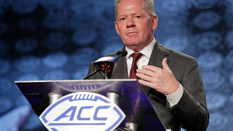 Louisville head coach Bobby Petrino speaks to the media during the Atlantic Coast Conference NCAA college football media day in Charlotte, N.C., Thursday, July 13, 2017. (AP Photo/Chuck Burton)