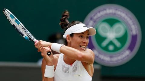 Spain's Garbine Muguruza returns to Slovakia's Magdalena Rybarikova, during their Women's Singles semifinal match on day nine at the Wimbledon Tennis Championships in London Thursday, July 13, 2017. (AP Photo/Kirsty Wigglesworth)