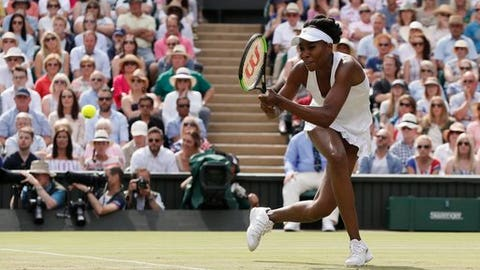 Venus Williams of the United States returns to Britain's Johanna Konta, during their Women's Singles semifinal match on day nine at the Wimbledon Tennis Championships in London Thursday, July 13, 2017. (AP Photo/Kirsty Wigglesworth)
