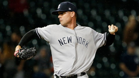 FILE - In this June 28, 2017, file photo, New York Yankees relief pitcher Tyler Webb throws against the Chicago White Sox during the ninth inning of a baseball game in Chicago. The Milwaukee Brewers have acquired left-handed reliever Tyler Webb from the New York Yankees for minor league first baseman Garrett Cooper. Webb was assigned to Triple-A following the trade Thursday, July 13, 2017. (AP Photo/Nam Y. Huh, File)