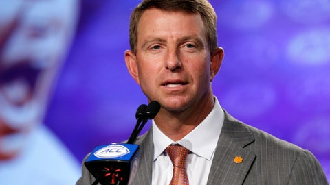 Clemson coach Dabo Swinney speaks to reporters during the Atlantic Coast Conference NCAA college football media day in Charlotte, N.C., Thursday, July 13, 2017. (AP Photo/Chuck Burton)