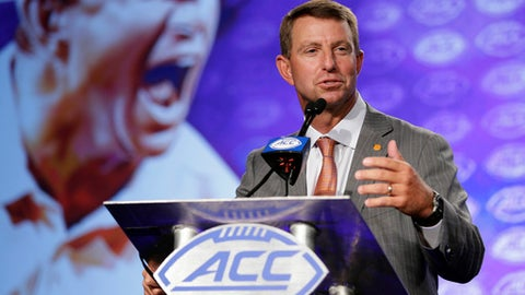 Clemson coach Dabo Swinney speaks during the Atlantic Coast Conference NCAA college football media day in Charlotte, N.C., Thursday, July 13, 2017. (AP Photo/Chuck Burton)