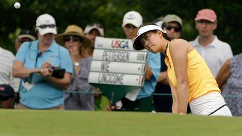 Michelle Wie chips onto the seventh green during the first round of the U.S. Women's Open Golf tournament Thursday, July 13, 2017, in Bedminster, N.J. (AP Photo/Seth Wenig)