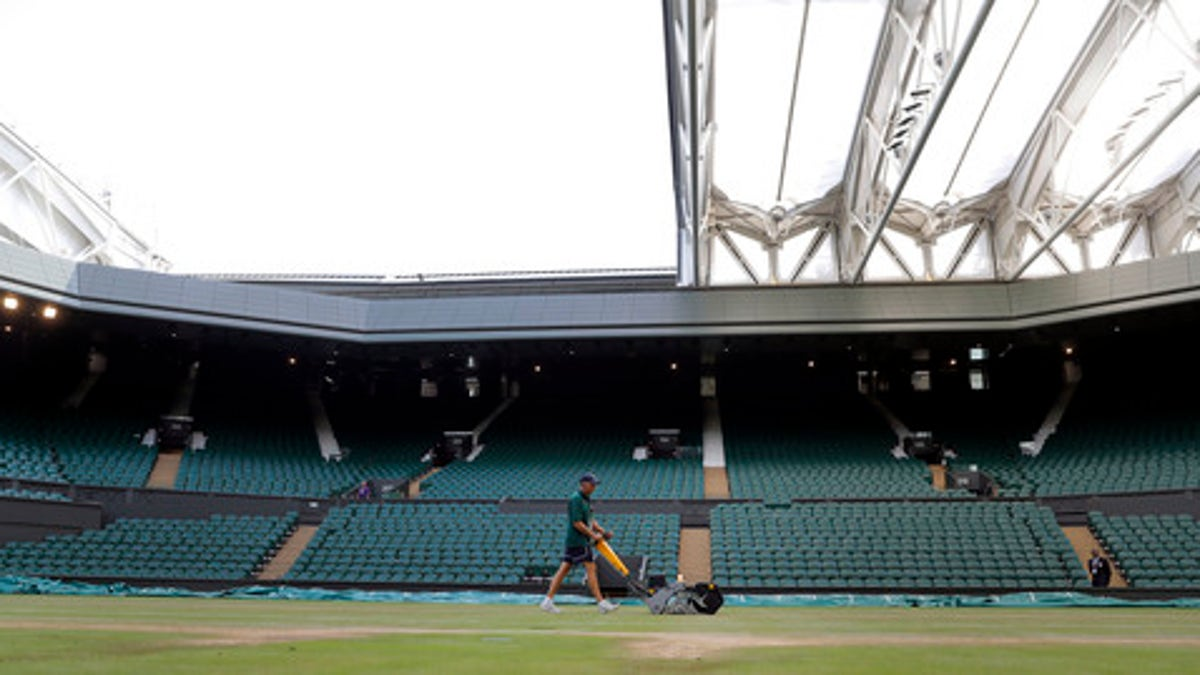 Every morning, they mow, paint, mop Wimbledon