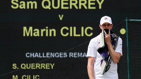 Sam Querrey of the United States waits for play to resume after a member of the crowd was taken ill as he plays against Croatia's Marin Cilic during their Men's Singles semifinal match on day eleven at the Wimbledon Tennis Championships in London, Friday, July 14, 2017. (AP Photo/Kirsty Wigglesworth)