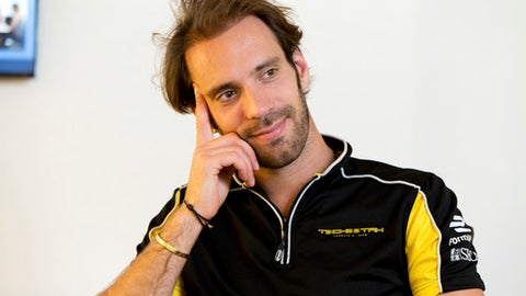 Formula E driver Jean-Eric Vergne is interviewed, in New York, Thursday, June 1, 2017. This weekend, a Brooklyn waterfront with a view of the Statue of Liberty will be transformed into a racetrack for the Formula E Championship series.(AP Photo/Richard Drew)