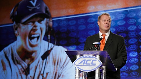 Virginia head coach Bronco Mendenhall speaks to the media during the Atlantic Coast Conference NCAA college football media day in Charlotte, N.C., Friday, July 14, 2017. (AP Photo/Chuck Burton)
