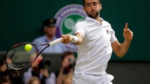 Croatia's Marin Cilic returns to Sam Querrey of the United States during their Men's Singles semifinal match on day eleven at the Wimbledon Tennis Championships in London Friday, July 14, 2017. (AP Photo/Alastair Grant)