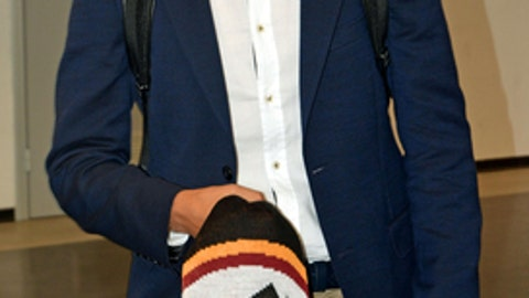 Roma new Turkish midfielder Cengiz Under arrives at the Leonardo da Vinci international airport in Fiumicino, near Rome, Friday, July 14, 2017. (Telenews/ANSA via AP)