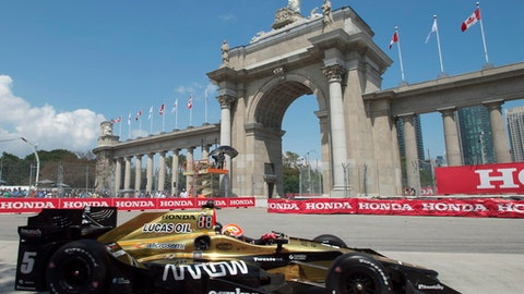 James Hinchcliffe drives in front of Princes' Gate during the second practice session for the Honda Indy Toronto, Friday, July 14, 2017 in Toronto. (Frank Gunn/The Canadian Press via AP)