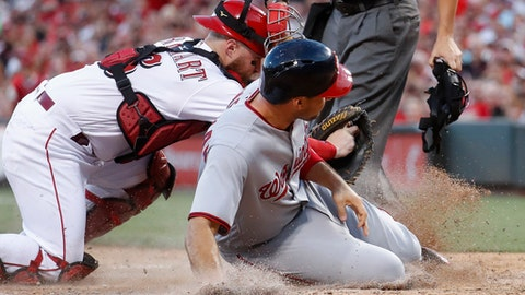 Cincinnati Reds catcher Tucker Barnhart tags out Washington Nationals' Ryan Zimmerman at home during the fifth inning of a baseball game, Friday, July 14, 2017, in Cincinnati. (AP Photo/John Minchillo)