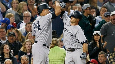 New York Yankees' Gary Sanchez (24) celebrates his two-run home run that also drove in Brett Gardner, right, during the fifth inning of a baseball game against the Boston Red Sox in Boston, Friday, July 14, 2017. (AP Photo/Michael Dwyer)