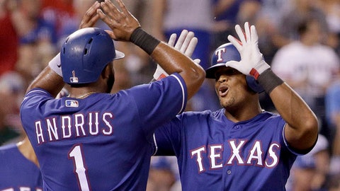 Texas Rangers' Adrian Beltre, right, celebrates with Elvis Andrus after hitting a three-run home run during the sixth inning of a baseball game against the Kansas City Royals, Friday, July 14, 2017, in Kansas City, Mo. (AP Photo/Charlie Riedel)h