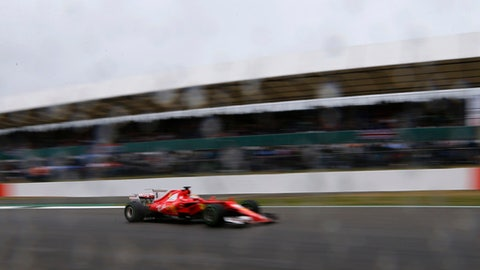Ferrari driver Sebastian Vettel of Germany steers his car during the third free practice session for the British Formula One Grand Prix at the Silverstone racetrack in Silverstone, England, Saturday, July 15, 2017. The British Formula One Grand Prix will be held on Sunday, July 16. (AP Photo/Frank Augstein)