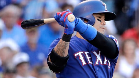 Texas Rangers' Shin-Soo Choo grounds out during the third inning of the team's baseball game against the Kansas City Royals on Saturday, July 15, 2017, in Kansas City, Mo. (AP Photo/Charlie Riedel)