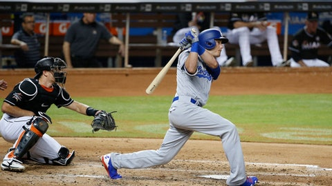 Los Angeles Dodgers' Cody Bellinger, right, watches his home run that also scored Chris Taylor during the third inning of a baseball game against the Miami Marlins, Saturday, July 15, 2017, in Miami. (AP Photo/Wilfredo Lee)