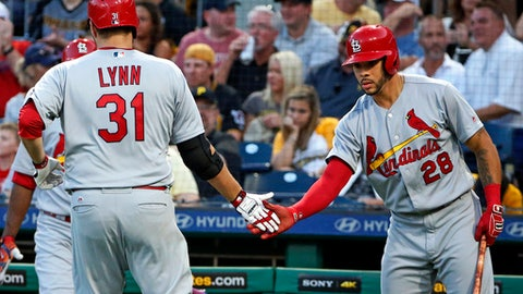 St. Louis Cardinals starting pitcher Lance Lynn (31) is greeted by Tommy Pham (28) after scoring on a single by Matt Carpenter off Pittsburgh Pirates starting pitcher Jameson Taillon in the fifth inning of a baseball game in Pittsburgh, Saturday, July 15, 2017. (AP Photo/Gene J. Puskar)
