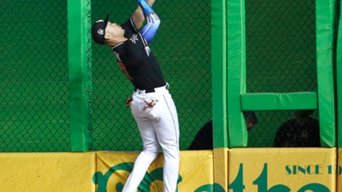 Miami Marlins right fielder Giancarlo Stanton is unable to hang on to a ball hit by Los Angeles Dodgers' Chris Taylor for a triple, during the sixth inning of a baseball game, Saturday, July 15, 2017, in Miami. (AP Photo/Wilfredo Lee)