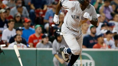 New York Yankees' Didi Gregorius runs on his RBI single during the 16th inning of the team's baseball game against the Boston Red Sox in Boston, Saturday, July 15, 2017. (AP Photo/Michael Dwyer)