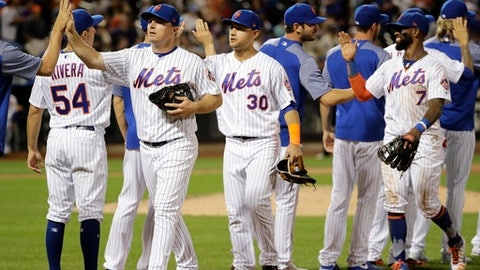 New York Mets' Jay Bruce, Michael Conforto (30) and Jose Reyes (7) celebrate with teammates after a baseball game against the Colorado Rockies, Saturday, July 15, 2017, in New York. (AP Photo/Frank Franklin II)