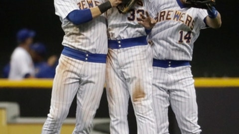 Milwaukee Brewers' Ryan Braun, Brett Phillips and Hernan Perez celebrate after the ninth inning of a baseball game against the Philadelphia Phillies Saturday, July 15, 2017, in Milwaukee. The Brewers won 3-2. (AP Photo/Morry Gash)