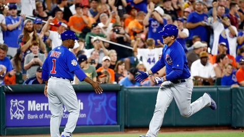 Chicago Cubs' Anthony Rizzo, right, rounds the bases past third base coach Gary Jones after hitting a solo home run in the eighth inning of a baseball game against the Baltimore Orioles in Baltimore, Saturday, July 15, 2017. (AP Photo/Patrick Semansky)