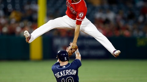 Tampa Bay Rays designated hitter Corey Dickerson slides under Los Angeles Angels shortstop Andrelton Simmons to steal second base on an errant throw from the catcher during the seventh inning of a baseball game in Anaheim, Calif., Saturday, July 15, 2017. (AP Photo/Alex Gallardo)