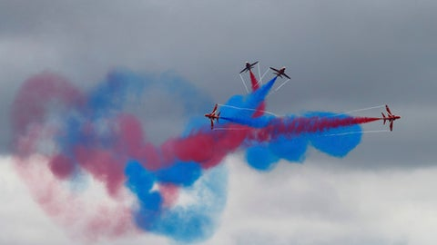 The Red Arrows, the Royal Air Force aerobatic team, perform above the circuit before the British Formula One Grand Prix at the Silverstone racetrack in Silverstone, England, Sunday, July 16, 2017. (AP Photo/Frank Augstein)