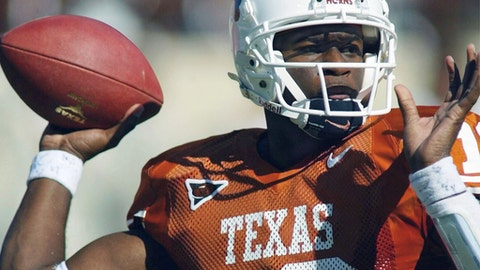 FILE - In a Oct. 16, 2004 file photo, Texas quarterback Vince Young looks for a receiver during the second quarter of Texas' 28-20 victory over Missouri in Austin, Texas. When the Big 12 kicks off its football media days on Monday, July 17, 2017, commissioner Bob Bowlsby will be able to tout a winning record in bowl games last season and the still-growing revenue for the league's 10 schools. What the league really needs this season is to get a team into the College Football Playoff. (AP Photo/Harry Cabluck, File)