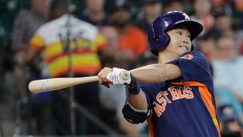 Houston Astros' Norichika Aoki hits a single against the Minnesota Twins during the second inning of a baseball game Sunday, July 16, 2017, in Houston. (AP Photo/David J. Phillip)