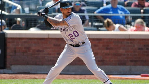 Colorado Rockies' Ian Desmond (20) waits for a pitch during the sixth inning of a baseball game against the New York Mets, Sunday, July 16, 2017, in New York. Desmond has been activated from the 10-day disabled list by the Rockies. He had been sidelined since July 3 with a strained right calf. (AP Photo/Kathy Willens)