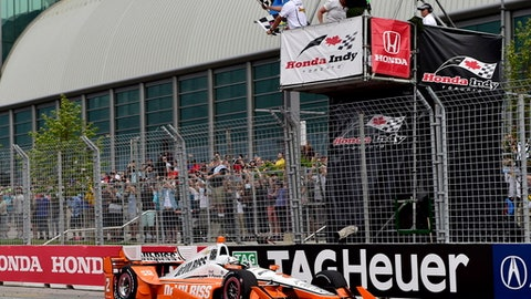 Josef Newgarden crosses the finish line to win the Honda Indy Toronto auto race in Toronto on Sunday, July 16, 2017. (Frank Gunn/The Canadian Press via AP)