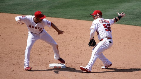 Los Angeles Angels' Kole Calhoun, right, and Andrelton Simmons celebrate their win over the Tampa Bay Rays in a baseball game, Sunday, July 16, 2017, in Anaheim, Calif. (AP Photo/Jae C. Hong)