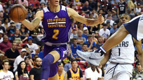 LAS VEGAS, NV - JULY 16:  Lonzo Ball #2 of the Los Angeles Lakers passes the ball under the basket against the Dallas Mavericks during a semifinal game of the 2017 Summer League at the Thomas & Mack Center on July 16, 2017 in Las Vegas, Nevada. Los Angeles won 108-98. NOTE TO USER: User expressly acknowledges and agrees that, by downloading and or using this photograph, User is consenting to the terms and conditions of the Getty Images License Agreement.  (Photo by Ethan Miller/Getty Images)
