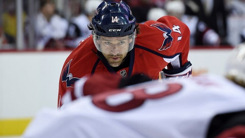 """FILE - In this March 25, 2017, file photo, then-Washington Capitals right wing Justin Williams (14), waits for a face-off during an NHL hockey game against the Arizona Coyotes, in Washington. The Carolina Hurricanes didn't bring back Justin Williams to be """"Mr. Game 7."""" Not yet, anyway. The 35-year-old with the reputation for scoring big postseason goals is being asked to bring veteran leadership and a voice of experience to a young Carolina team. (AP Photo/Molly Riley, File)"""