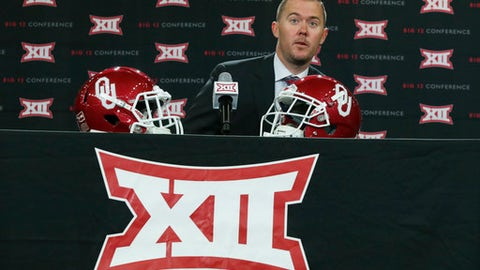Oklahoma head coach Lincoln Riley takes his seat on the dais before speaking to reporters during the Big 12 NCAA college football media day in Frisco, Texas, Monday, July 17, 2017. (AP Photo/LM Otero)