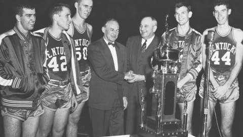 In this Dec. 23, 1954, photo, Kentucky basketball coach Adolph Rupp, third from right, is congratulated by LaSalle coach Ken Loeffler as Kentucky players look on after the championship game of the Kentucky Wildcats Invitational college basketball tournament, in Lexington, Ky. Players fropm left are Linville Puckett, Bill Evans, Bob Burrow, Jerry Bird and Phil Grawemeyer. Former Kentucky basketball player Jerry Bird, second from right, who was a member of the school's Athletics Hall of Fame and had his No. 22 jersey retired to the Rupp Arena rafters, has died. An obituary posted by O'Neil-Lawson Funeral Home says Bird died Sunday, July 16, 2017, at a hospital in Corbin. (Lexington Herald-Leader via AP)/Lexington Herald-Leader via AP)