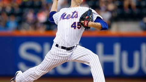New York Mets starting pitcher Zack Wheeler delivers during the first inning of the team's baseball game against the St. Louis Cardinals on Monday, July 17, 2017, in New York. (AP Photo/Kathy Willens)