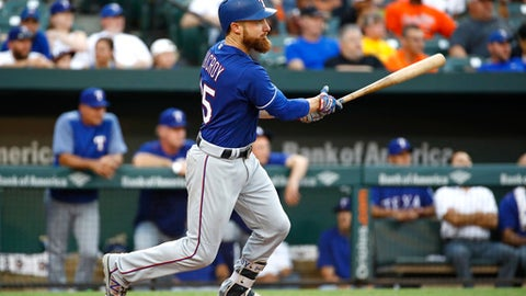 Texas Rangers' Jonathan Lucroy watches his RBI double during the second inning of the team's baseball game against the Baltimore Orioles in Baltimore, Monday, July 17, 2017. (AP Photo/Patrick Semansky)