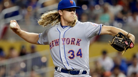 FILE - In this April 14, 2017, file photo, New York Mets pitcher Noah Syndergaard throws during the first inning of the team's baseball game against the Miami Marlins in Miami. Syndergaard and Matt Harvey began their throwing programs Monday, July 17, playing catch together at Citi Field in their first steps toward returning to the mound for the Mets. Whether either one gets back in time to make a difference this season, well, that remains to be seen. (AP Photo/Lynne Sladky, File)